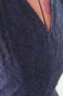 Beautiful early 1950s navy blue party dress. Dress is fully lined in